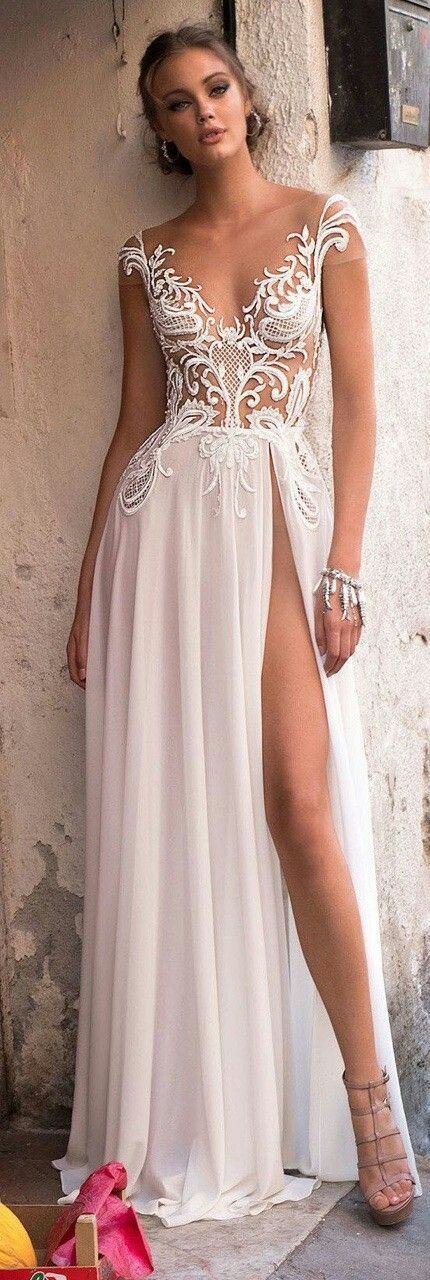 Modern wedding dress collections/ 2018/ Follow me @ Melissa Riley- for more modern wedding dress collections, wedding cakes, modern eye makeup ideas, modern wedding reception decor and lighting, unique wedding photo ideas, wedding bouquets, women's fashion and more. lovemelissariley.com