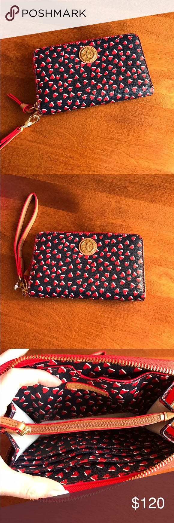 NWT Tory Burch Wristlet NWT Tory Burch Wristlet! Valentine's Day Karrington Smartphone Wristlet! Colors are red white tan and navy! Never used back pocket is stretched for standard iPhone 6 and iPhone 7 size with out case or with thin case! Tory Burch Bags Clutches & Wristlets