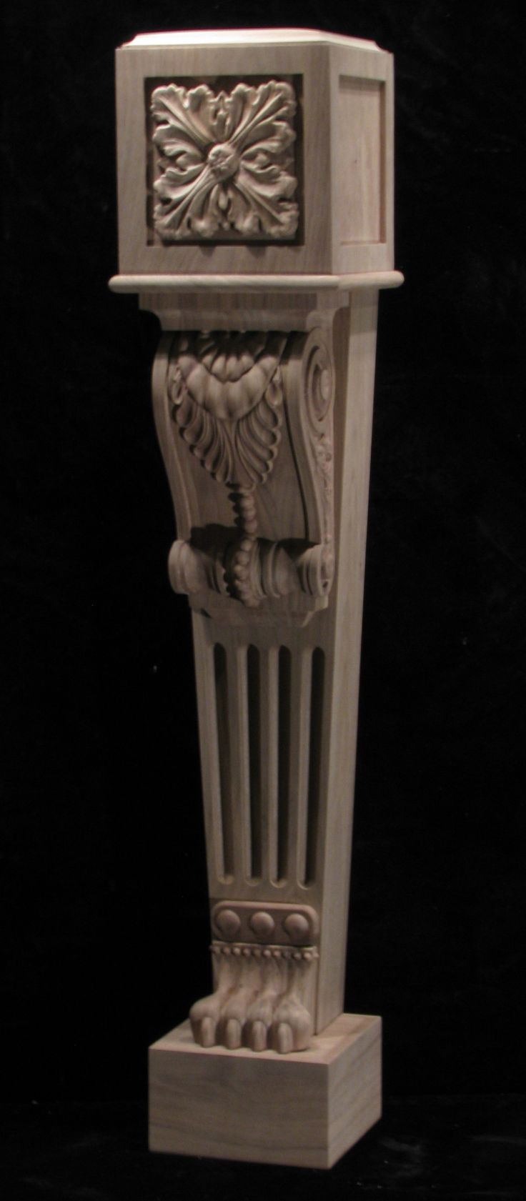 Carved newel post featuring the lion paw at the bottom