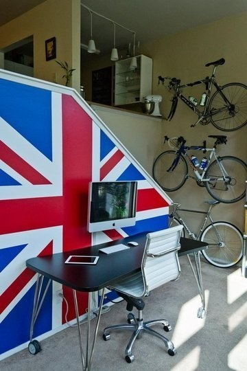 At least a few fun ideas in this photo for split-level homes or condos: a large graphic union jack flag, VESA wall mount for communal iMac, vertical bike storage near the door. Kinda crazy, but I could pull it together. Imagine crisp white walls and wood floors.