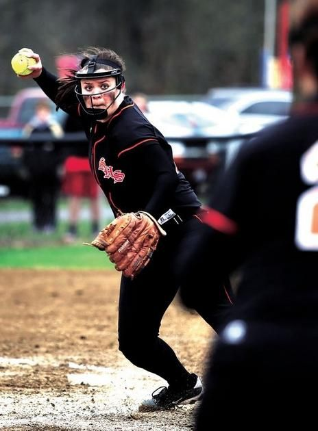Strasburg High School pitcher Hannah Duff fields a ball for an out at first during Thursday's game against Tuscarawas Central Catholic in Strasburg. Duff got the win as pitcher and hit a double and single.