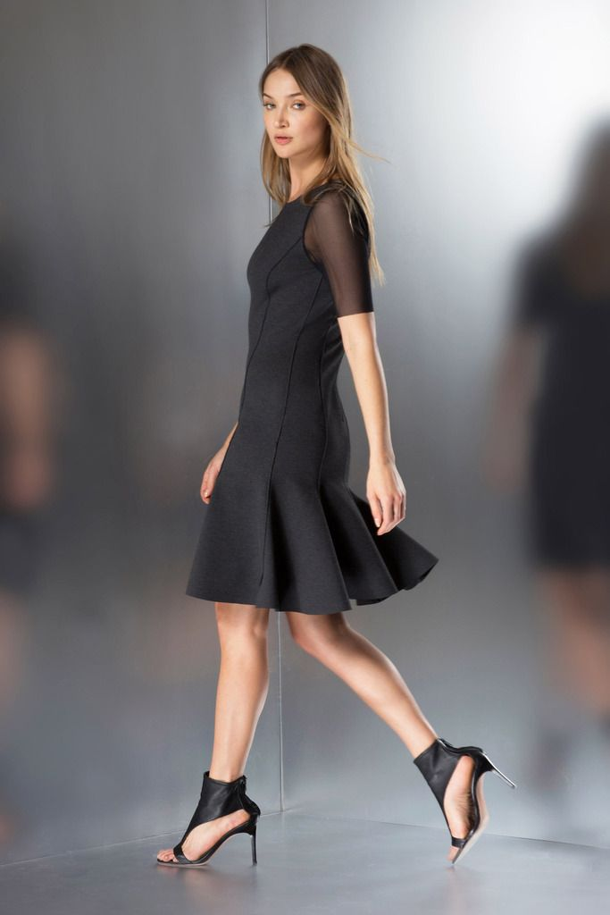 Kaelen haworth black tent dress with killer heels and red lipstick image