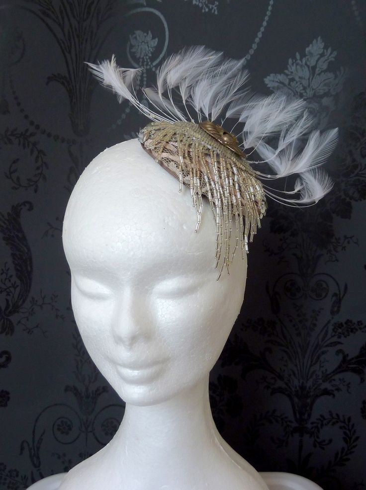 Cocktail hat silver/Melbourne cup hat Grey handblocked base, beige lace and silver beads and mask. White feather splay.