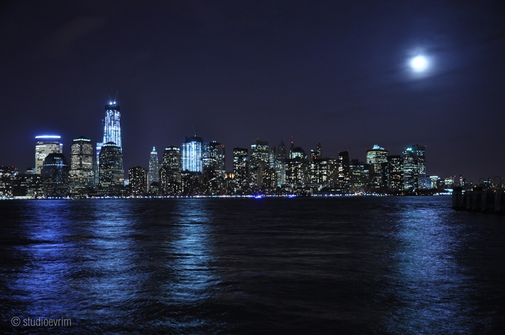 NYC downtown under a full moon sky. Taken from Liberty State Park, Jersey City, NJ