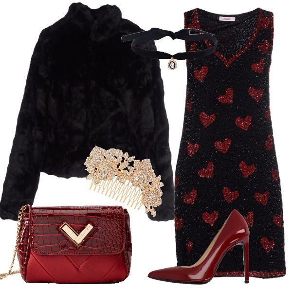 Il vestito nero con cuori rossi è tutto ricoperto da paillettes perfetto per un festeggiamento nel segno dell'amore. Si abbina al caban corto in eco-pelliccia nera . Per completare décolleté rosso scuro a tacco altissimo e borsetta anch'essa rosso scuro in due stampe con tracolla a catena dorata. Per finire i gioielli, fondamentali per splendere ancora di più, ecco allora un collarino in velluto nero con pendente cammeo e un pettinino per capelli dorato con pietre luminosissime.