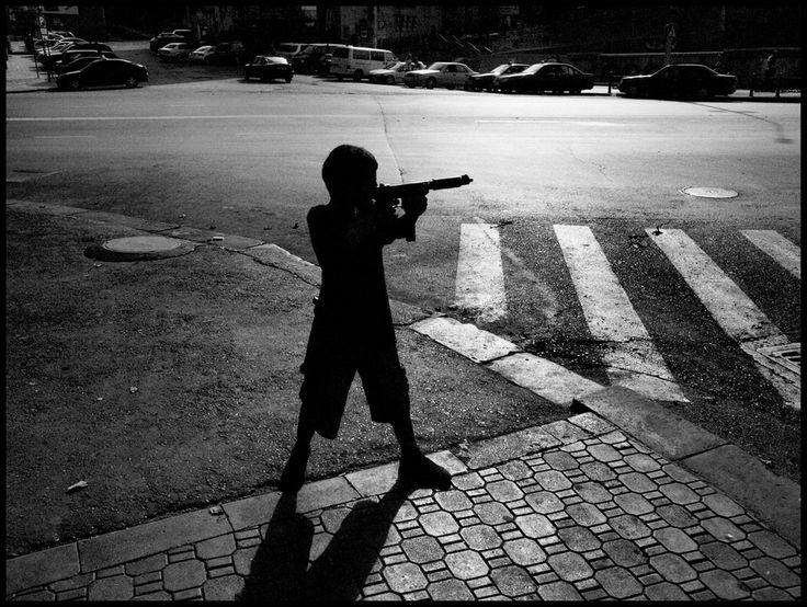 Alex Majoli. GEORGIA. Tblisi. 2008. Kid playing on the street.