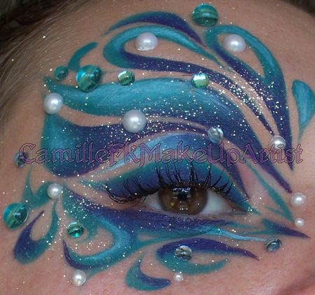 Exotic blue aquatic themed fantasy eye makeup with crystal accents.