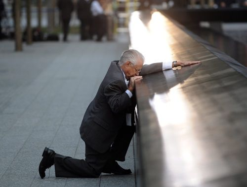 REMEMBERING 9/11 Robert Peraza, who lost his son Robert David Peraza, pauses at his son's name at the North Pool of the 9/11 Memorial during tenth anniversary ceremonies at the site of the World Trade Center.