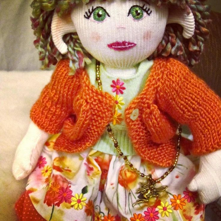 'Poppy', the third faerie from my MaerieFaerie doll collection. Made from recycled clothing and fabrics, vintage trims, and thrift store finds. Stuffing is 100% recycled polyester.