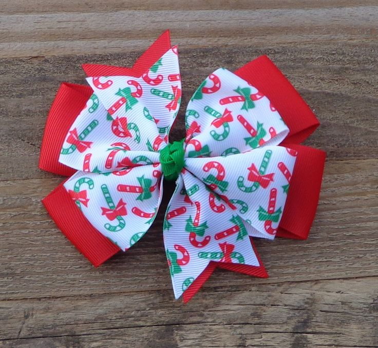 Christmas Boutique Hair Bow~Christmas Hair Bow~Red and Green Hair Bow~Holiday Hair Bow~Red Holiday Hair Bow~Christmas Bows~Candy Cane Bow by LizzyBugsBowtique on Etsy https://www.etsy.com/listing/207989395/christmas-boutique-hair-bowchristmas