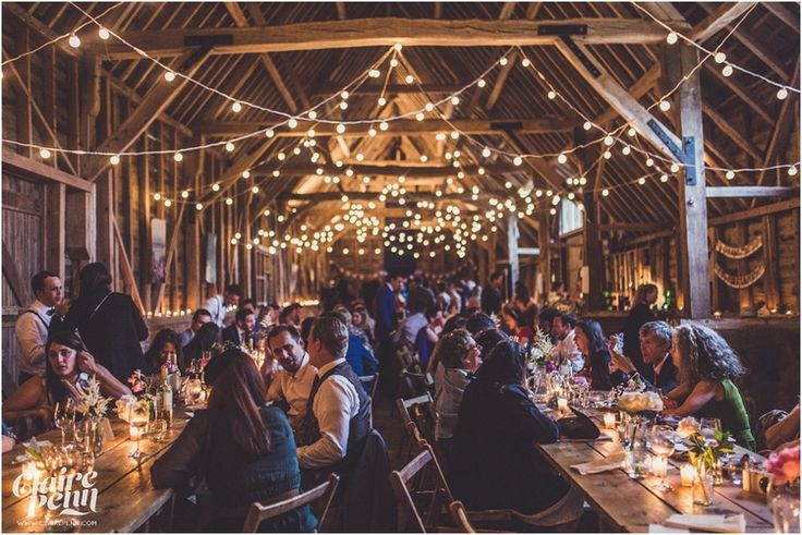 Photo: Claire Penn Photography. Creative, rustic North Hidden Farm barn wedding in Hungerford Berkshire Festoon lights by Oakwood Events