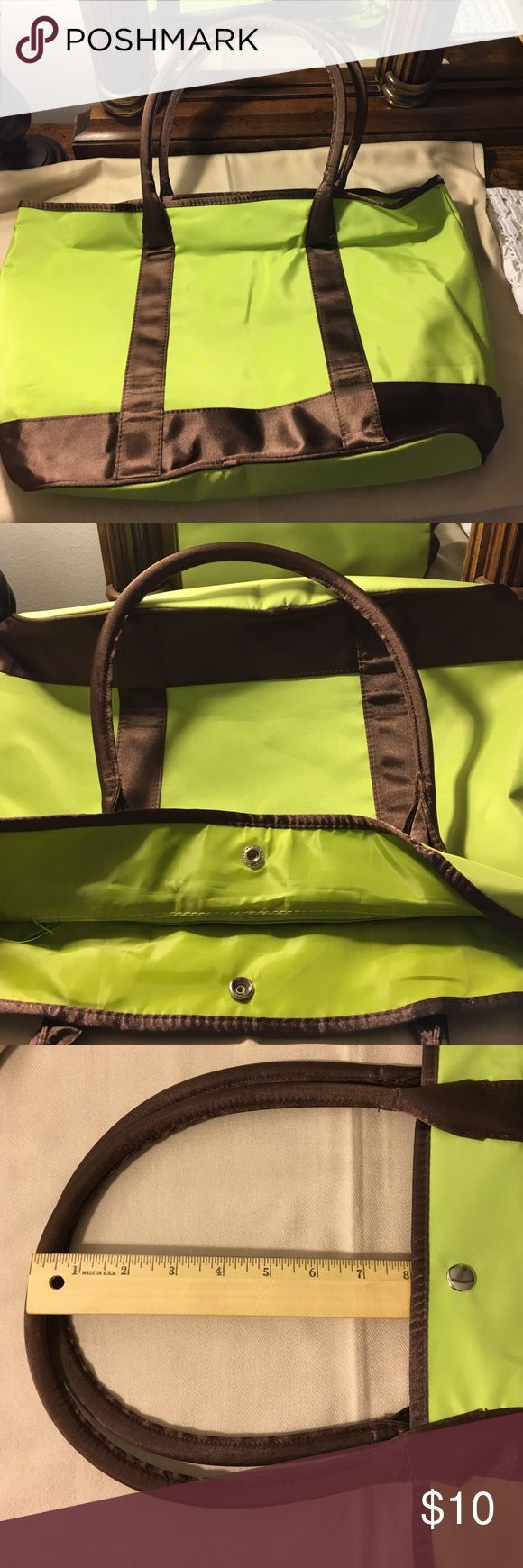 Lime green and brown tote bag Lime green and brown tote bag.  Has a zipper pouch and two pockets.  The last picture shows a folder a three ring binder, folders and notepad, this is not included.  This is to show how large the bag is. Bags Totes