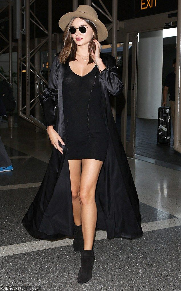 Legging it! Miranda Kerr had heads turning on Tuesday when she was spotted making her way through Los Angeles airport in a slinky little black number with a racy thigh-high hem