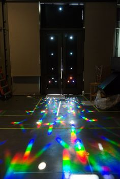 """These were created by blocking the light on two glass doors with big paper, cutting out holes, and then placing diffraction grating over the holes."""
