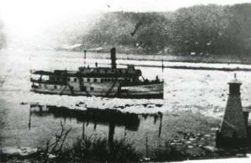 This early spring photograph shows the Majestic passing a river lighthouse. These structures were very important navigation markers on the St. John River.