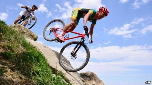 "Burry Stander on his bike during the London Olympics (12 August 2012). He was knocked off his bike 3 January 2013 and died.   ""There will never be another Burry Stander. We have lost a hero, a great South African and an athlete… someone who has given it his all when it comes to sport,"" Fikile Mbalula South African Sports Minister"
