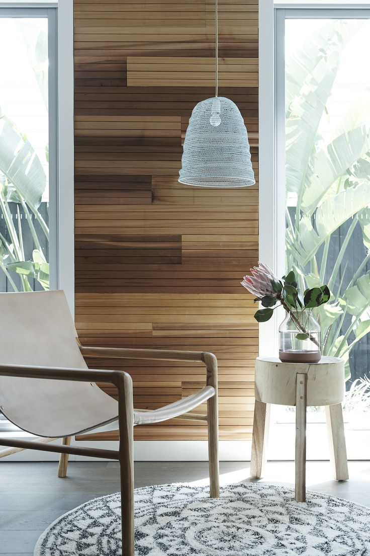 I created a cedar feature wall and stained this in Feast Watson's Scandinavian Oil. Partnered with the Smith leather sling chair by Barnaby Lane and side table and rug by House of Orange. A pendant light by Marmouset Found added a soft ambiance to the room.