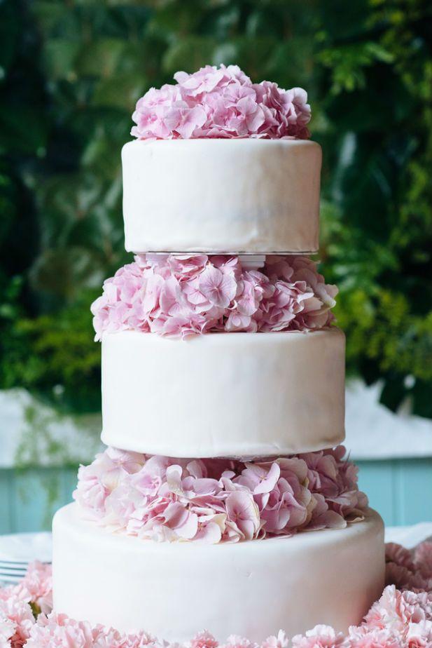 Simple elegant three tier fondant wedding cake with pink flowers (Alexander Masters)