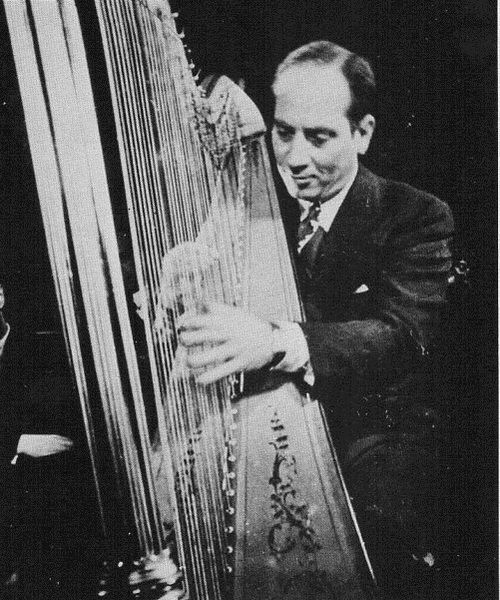 Harpo Marx out of make-up playing the harp in Russia.