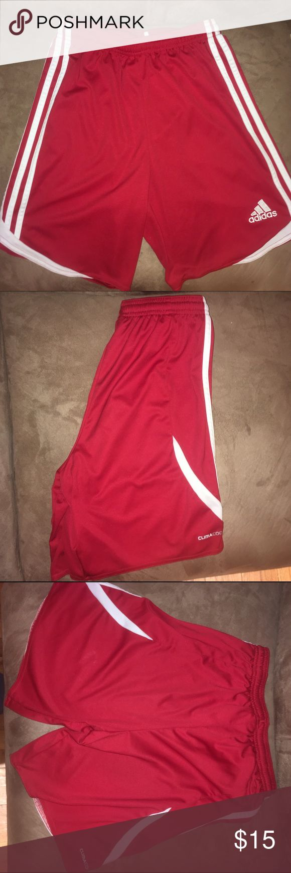 Adidas Soccer Shorts Red Addidas Soccer shorts with white stripes, clean, no stains, comfortable, smoke free, ask all questions! Size: Large in kids, would fit a women's small Adidas Bottoms Shorts