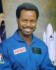 Ronald Ervin McNair, Ph.D. (October 21, 1950 – January 28, 1986) was a physicist and NASA astronaut. McNair died during the launch of the Space Shuttle Challenger on mission.In the summer of 1959, he refused to leave the segregated Lake City Public Library without being allowed to check out his books. After the police and his mother were called, he was allowed to borrow books from the Library, which is now named after him.