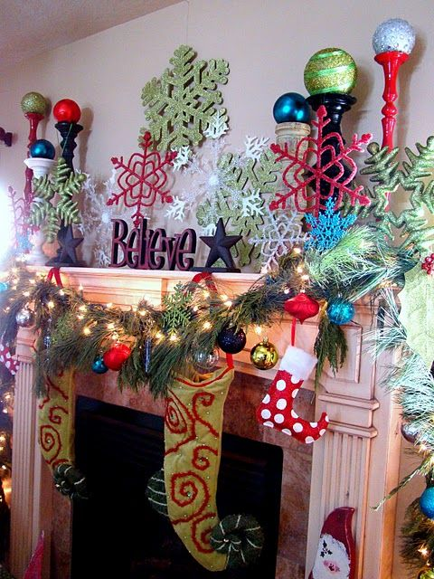 Wow, busy but fun.  Different, bright candlesticks, various colored large snowflakes, one-word statement, bright stockings - I assume the odd one out is for a pet or something