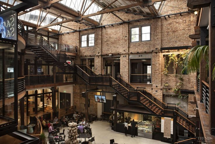 Heritage preservation and adaptive reuse of historic warehouse provides new offices and showrooms, with central café in large atrium