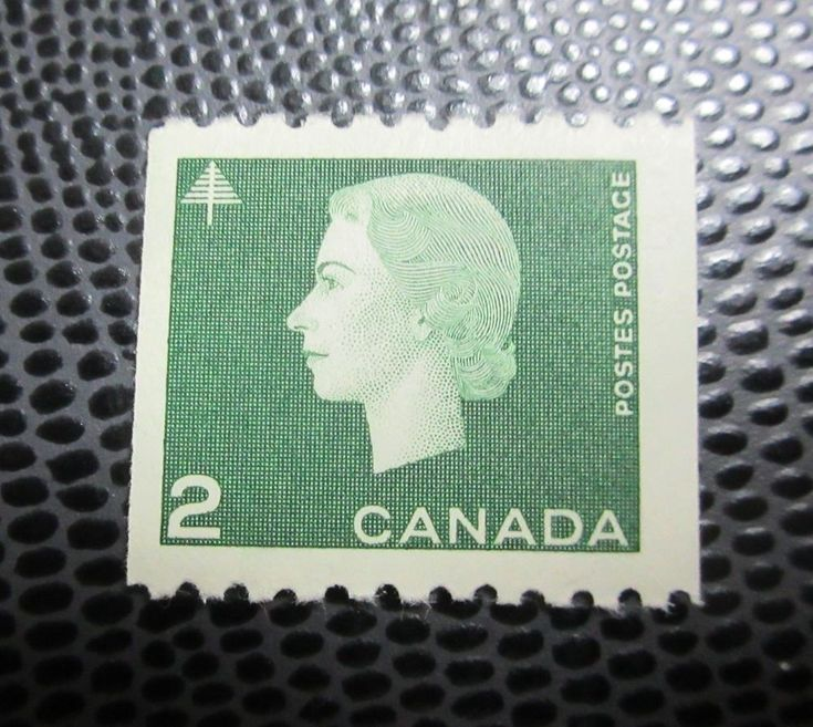 # 406 mint hinged coil stamp Queen Elizabeth Cameo Canada