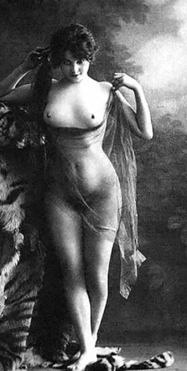 Vintage erotic nude postcards something is
