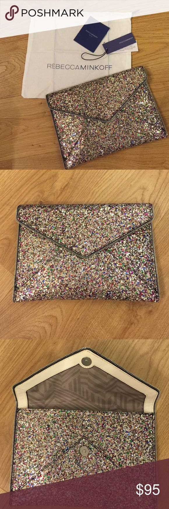 NWT- Rebecca Minkoff Glitter Clutch! Rebecca Minkoff Leo Envelope Clutch. Silver/ multicolored glitter! NWT perfect condition. Credit card holders on inside with flap closure. Purchased from Nordstrom in Dec 2016. Currently sold out on Nordstrom and Neiman Marcus. Comes with dust bag. Rebecca Minkoff Bags Clutches & Wristlets