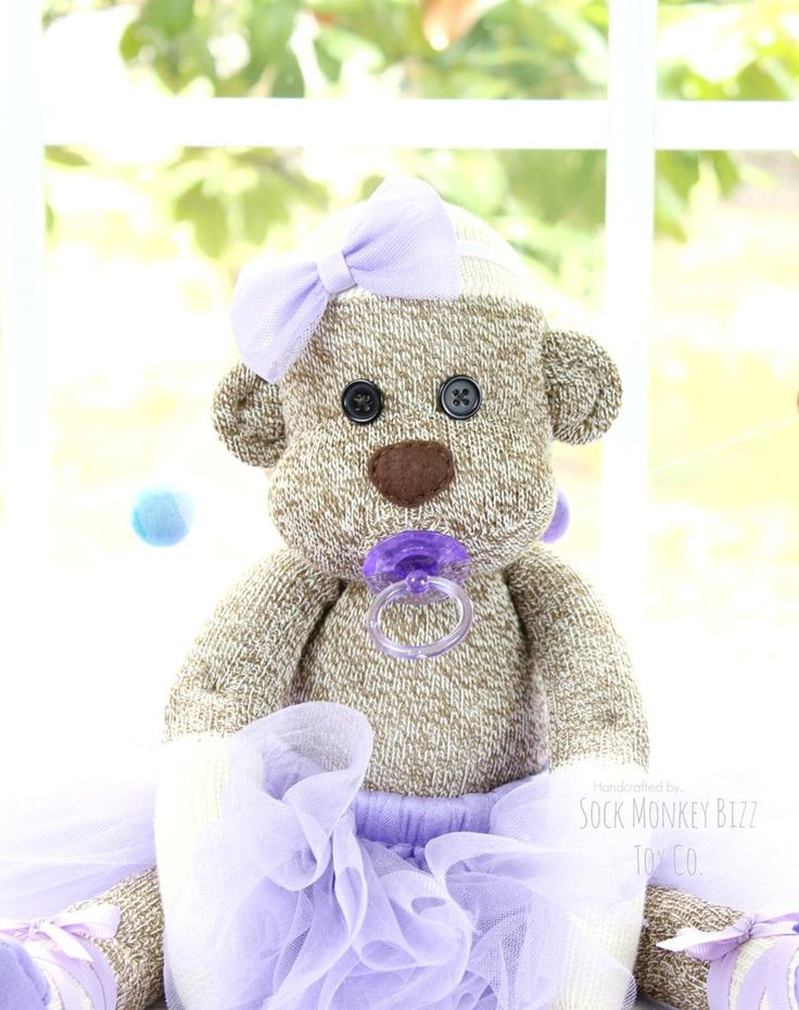Ballerina Baby Sock Monkey Doll, Lavender Rose Includes - -Baby Sock Monkey Doll with Pacifier -Tutu, Shoes, and Headband/ Bow Due to the monkey's eyes and pacifier, this toy is not suitable for babie
