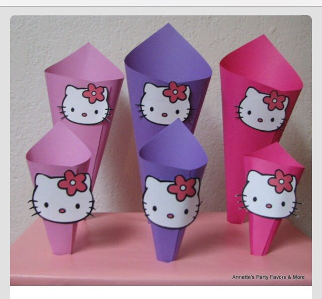 Simple DIY cones for snacks, treats etc... Simply print out a hello kitty template, roll up some construction paper glue edges to hold in place and glue the hello kitty face! Super easy!