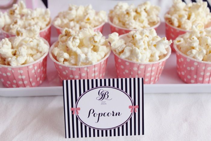 popcorn or small snacks in cute cupcake wrappers (and then you can use the cupcake-tiered holder)
