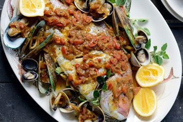 Whole roasted fish with shellfish and spicy tomato fumet