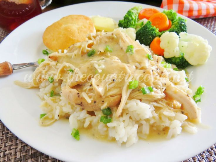 Crockpot Chicken in Gravy 2 (0.87 oz.) packets dry chicken gravy mix 1 (10.75 oz.) can cream of chicken soup 2 cups water 1 lb. boneless, skinless chicken breasts garlic powder, salt & black pepper, to taste 1/2 cup sour cream (optional) rice, mashed potatoes or noodles to serve over