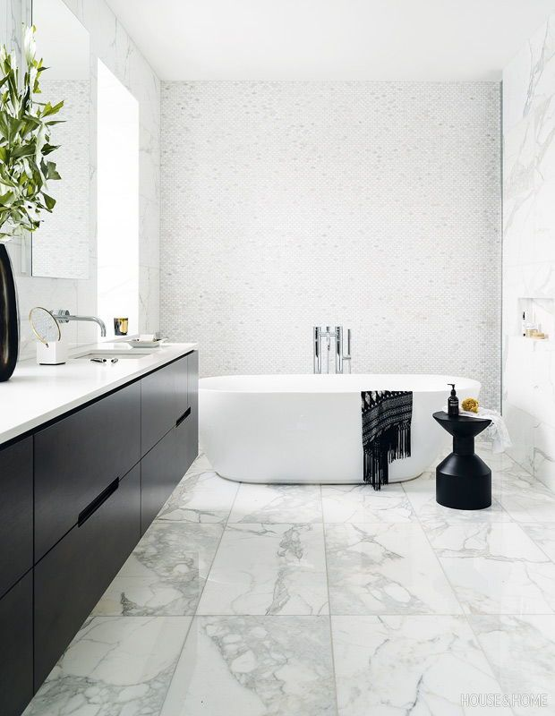 Tour A Black White Bathroom Adorned With Marble Marble Bathroom Designs Black White Bathrooms Modern White Bathroom