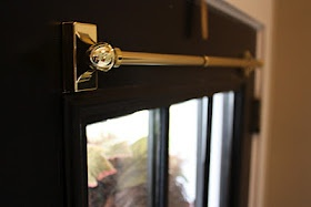 Good idea: using a magnetic curtain rod on a metal door to cover windows. Remove whenever you want!