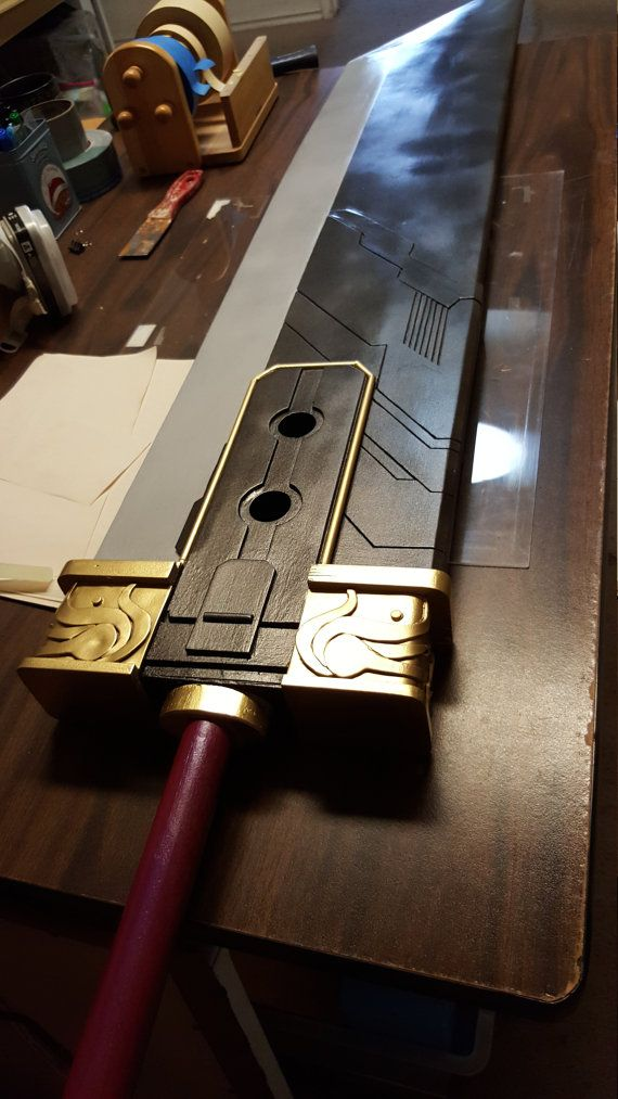 """Final Fantasy 7 Crisis Core Buster Sword by CoffeeCosplay. This is a lifesize replica of the iconic sword itself (6'1""""). OO and did I mention it's under 10lbs?"""