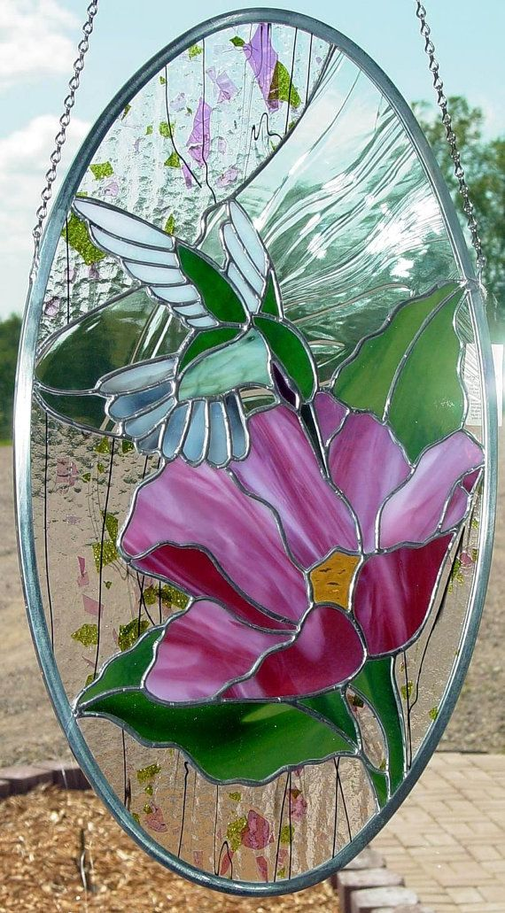 Hummingbird and Flower Stained Glass Panel Suncatcher on Etsy, $368.00..........wow, expensive but still beautiful