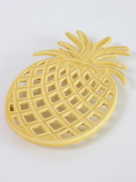Pineapple Trivet: Lovers of pineapples behold! A tutti frutti shaped trivet for your kitchen.