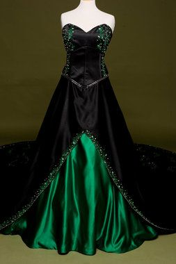 Black wedding dress with gorgeous gothic style.  This colored wedding dress has gorgeous emerald green vine embroidery.  Perfect for a Halloween, gothic, or nerd wedding with offbeat style.