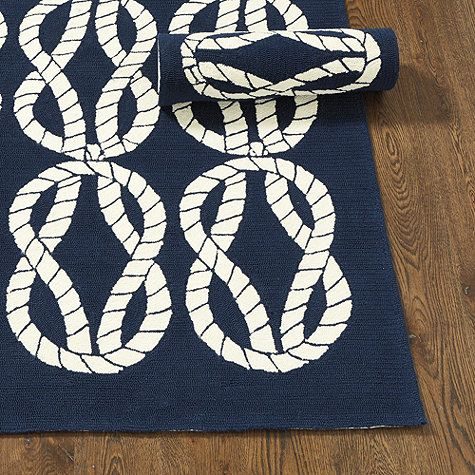 Flowing white sailor knots are hand looped on a crisp navy ground, giving our Seafarer Indoor/Outdoor Rug a fresh, nautical look. Hand woven of soft, washable, UV-treated polypropylene. Use of a rug pad is recommended.Seafarer Indoor/Outdoor Rug features:Great for high-traffic, spill-prone areasSizes are approximatePattern scale & repeat will vary with rug sizeImported