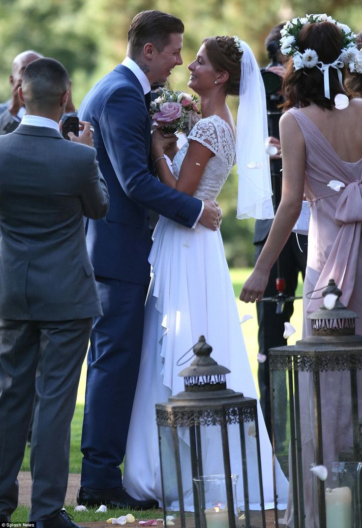 So much happiness: The newlyweds can't contain their joy as they pose for wedding photos after the ceremony