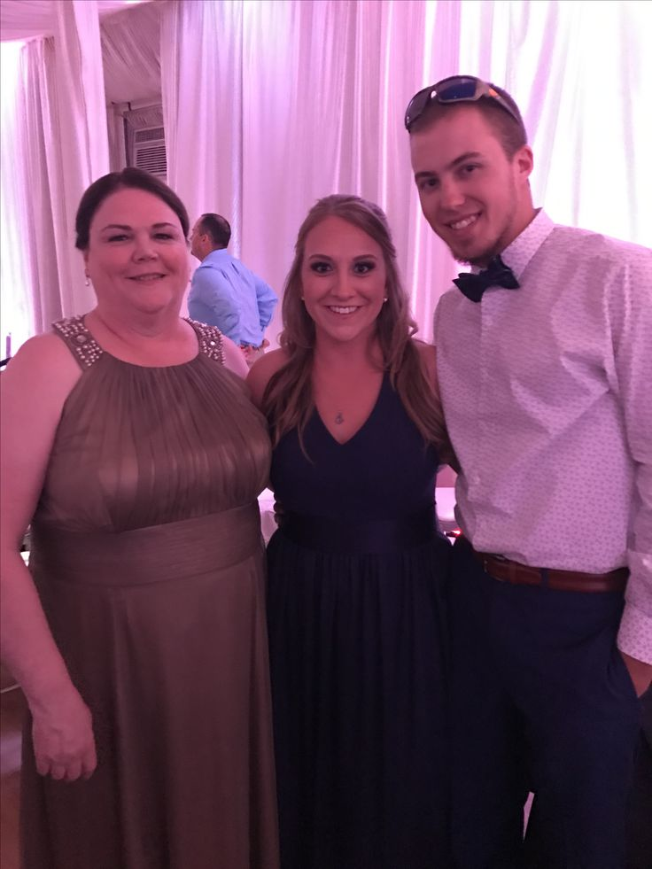Mother and sister of the groom with sister's boyfriend