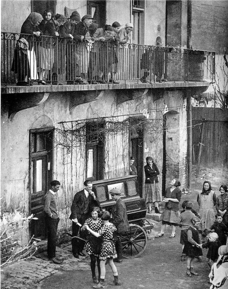 Budapest, 1923  Martin Munkacsi.  Girls dancing in the street to the organ grinder's music