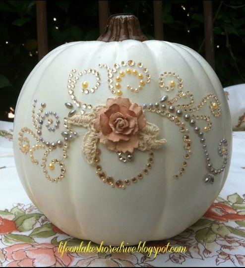 Pumpkin w/ pretty design, would use artificial halloween white pumpkins so these can be made in advance.