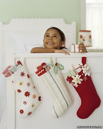 Rickrack Stocking    Line the mantel -- or a child's bed -- with colorful handmade stockings that invite stuffing. These felt socks, cut with scallop scissors, are embellished with rickrack zigzags or blooms. You can scatter the blossoms or cluster them in a cuff.