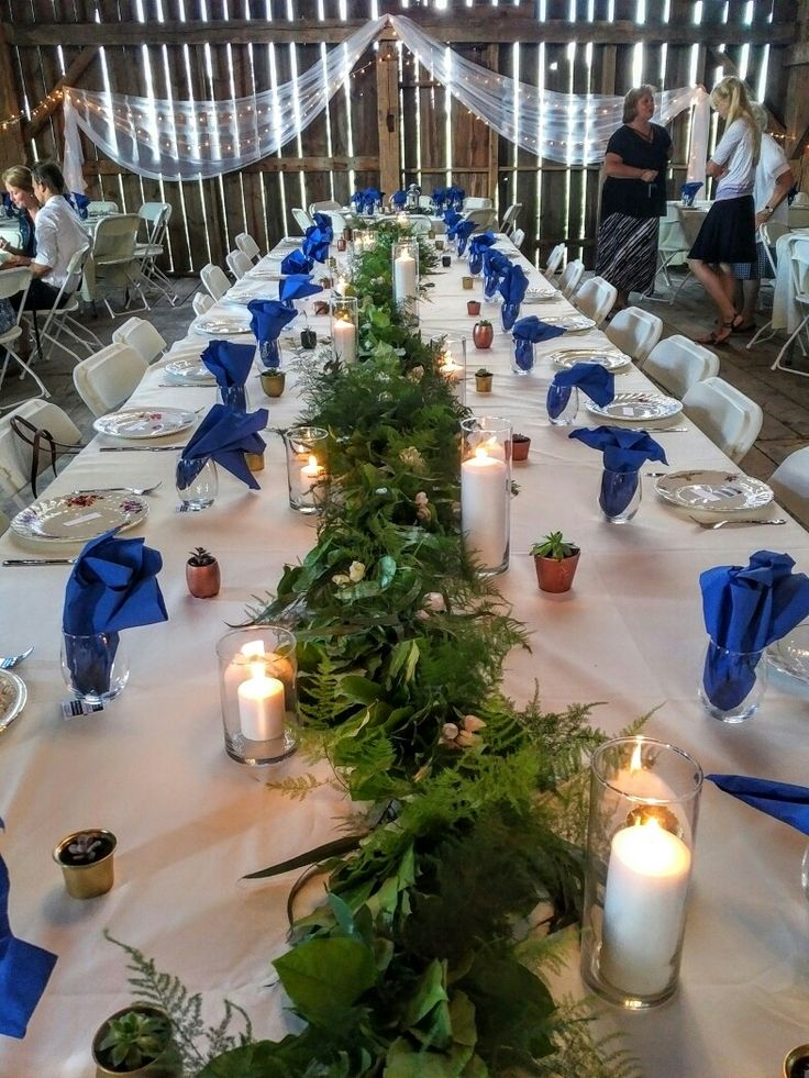 Perfect garland/table runner topped off with perfect majolica spray roses.  fern, italian ruscus, seeded eucalyptus, parvifolia...
