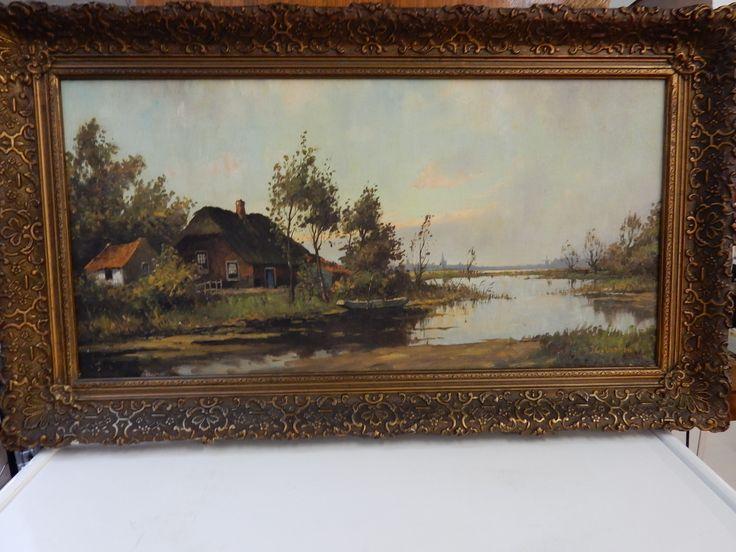 Prachtig schilderij van boerderij aan vaart met aan de horizon een dorpsgezicht. Het schilderij is ingelijst in een goud vergulde antieke lijst. De afmetingen van het doek zijn ongeveer 80 bij 40 cm en het totaal is ongeveer 95 bij 55 cm. Het schilderij is gesigneerd en in uitstekende staat. Prijs € 125.00.