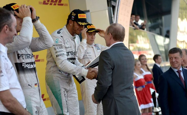 Vladimir Putin presented the cup to Lewis Hamilton, winner of the Russian stage of the Formula One World Championship.
